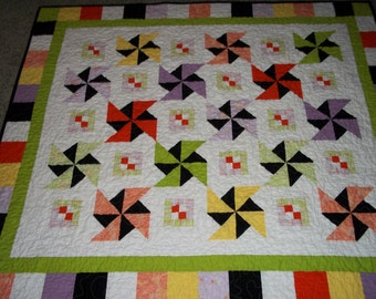 Colorfull double pinwheel lap quilt