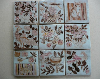 Handpainted tiles -  bird, cat and flower designs on terracotta