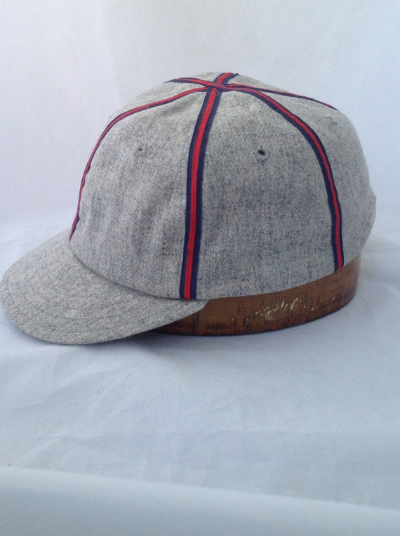 Fitted baseball cap in soft light grey wool flannel with red/blue braid. 19th century era visor style. All sizes available.