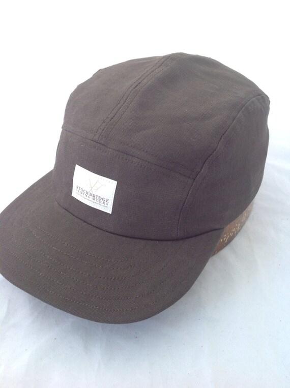 Five panel cap, dark army green twill, flat visor, adjustable buckle, cotton sweatband