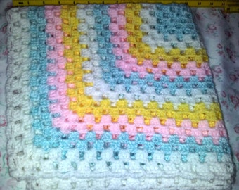 Small granny square afghan blanket.