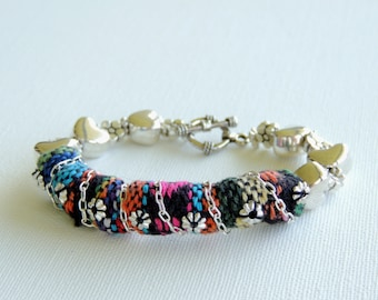 A cool mix of colorful cotton and sterling silver chain and sterling silver beads bracelet