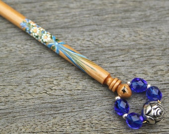 Painted Lace Bobbin - bouquet tied with blue ribbon on Boxwood