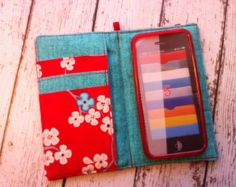 Red, aqua, and pink cherry blossom print wallet for HTC Evo, Desire, Inspire, Thunder Bolt, and Droid with removable gel case