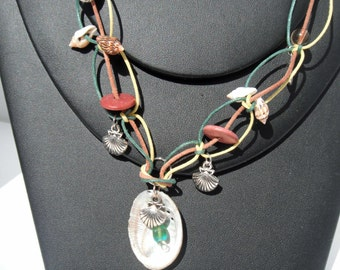Seashells attached with Macrame knots on Yellow, Green and Brown Cord with Metal shell charms