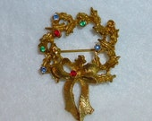 Christmas Wreath L J M Brooch Vintage Jewelry Pin with Multi Colored Rhinestones Green Red Blue in Gold Tone Setting Collectable