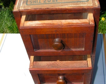 A true piece of folk art furniture in this three drawer cabinet made from an old Industria corned beef box.