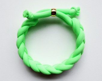 the braid bracelet - handmade with neon fabric and a gold stainless steel bead