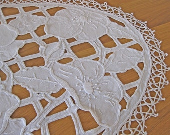 white linen cloth with embroidered flowers and cutwork - oval French doily with crochet lace border