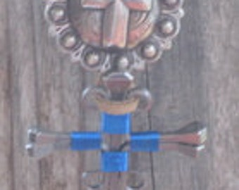 Saddle conchos with hand wrapped nail cross