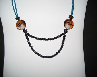 Beaded necklace with swirled glass beads