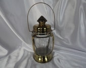 Unusual Brass candleholder, clear glass, Also a Music Box