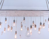 Reclaimed barnwood lighting with quartz crystals and edison bulbs