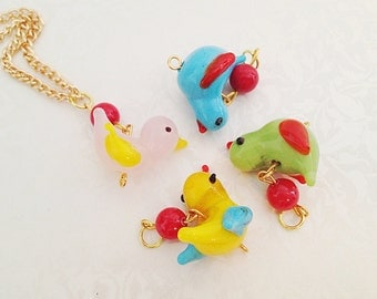 Colorful Glass Bird Necklace. Whimsical. Rainbow. Fun. Cute. Little Birds. Blue. Red. Pink. Green. Summer. Gold Chain. Woodland.