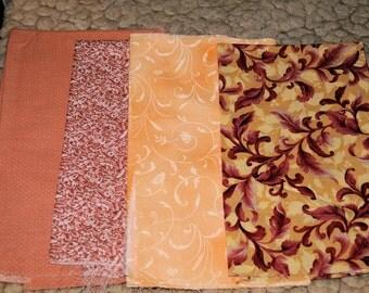 More Orange Prints Cotton Fabric