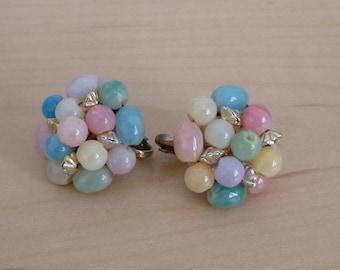 Multi colored pastel clip earrings.