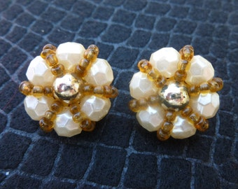 Circle white and brown clip earrings.