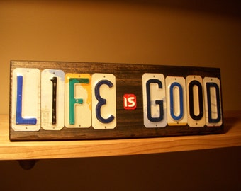 LIFE is GOOD sign made with recycled license plates.