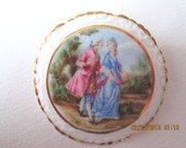 ON HOLD: English Coalport porcelain brooch with scene of 18th century couple walking