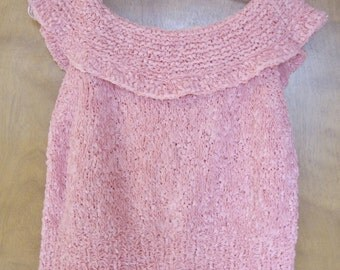 Pink hand knitted top.