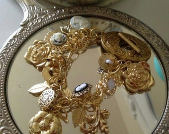 Gilded Age inspired gold charm bracelet with amazing toggle clasp