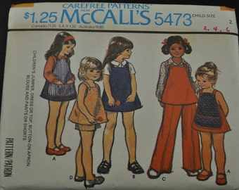 Girls' Jumper, Dress or Top, Button-On Apron, Blouse and Pants or Shorts Size 2 Uncut Vintage 1970s Sewing Pattern McCall's 5473