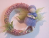 Waldorf Inspired Fairy Wreath with Naturally dyed soft pink Wool Yarn, and a needle felted fairy in lavender and chartreuse