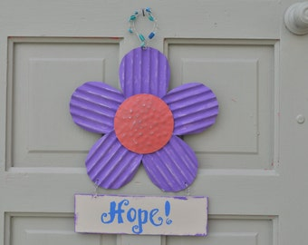 painted flower, metal with the word hope hanging below