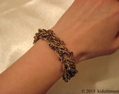 Hand crochet bead bracelet in bronze and gold colors