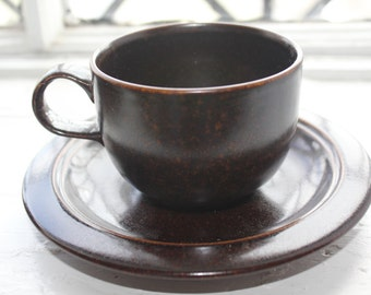 Two vintage stoneware coffee cups by Arabia Finland