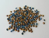 100 Swarovski Montana blue crystal rhinestone chatons with gold foil. 14pp 6ss 2mm