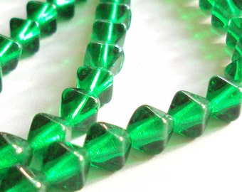 Czech glass Emerald green x 100, 8mm bicone, pressed beads