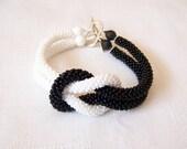 Beadwork - Bead Crochet Bracelet in black and white - Beaded Bracelet - Infinity Knot Bracelet - Beaded Bracelet Cuff