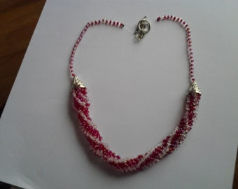 Red and white handwoven spiral necklace