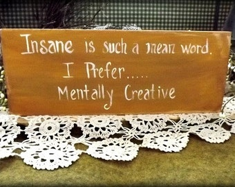 """Free hand painted ,Funny wood sign. """"Insane is such a mean word, I prefer...Mentally creative"""""""
