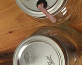 Mason Jar lids with a drinking straw hole. A set of 4.  Choose between Gingham or Plan.