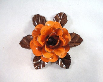Medium Size Decorative Metal Hand Cut and Hand Painted Rustic Orange Rose Mounted on a Bed of Metal Leaves.