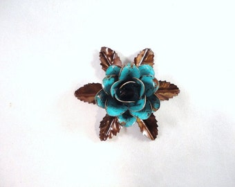 Small Size Decorative Metal Hand Cut and Hand Painted Rustic Turquoise Rose Mounted on a Bed of Metal Leaves.
