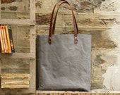 Oversized tote. Thick leather straps. Washed grey canvas. Cotton stripe lining.