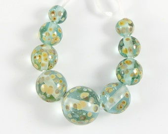 Turquoise Glass Beads speckled with raku frit, round Bead Set of 9