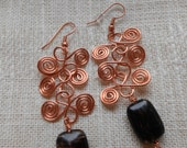 Copper Egyptian scroll dangle earrings with black tourmaline.