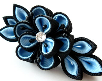 Kanzashi fabric flower hair clip. Black and blue.