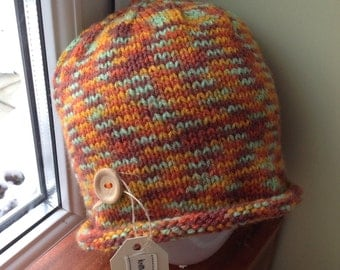 Hand-knitted beanie hat in shades of orange, green and brown - all sizes