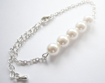 Elegant white pearl bracelet on silver chain