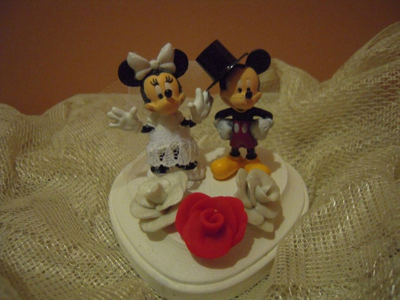 mickey and minnie mouse wedding cake toppers uk mickey mouse and minnie mouse wedding cake topper disney 17343