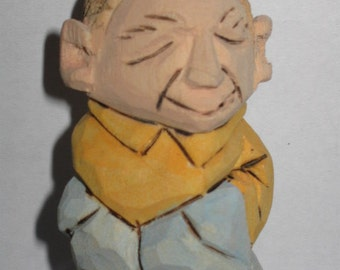 Miniature carved man.