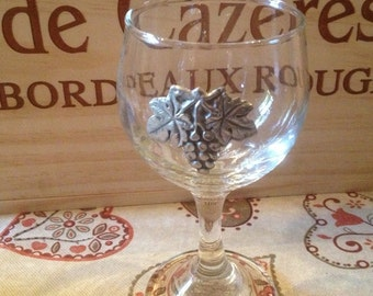 Vintage wine glass with pewter grapes