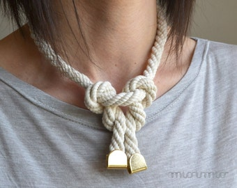 Eco friendly statement necklace with cotton ropes .