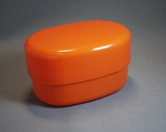 Oval lunch box compact design for easy storage.