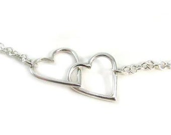 Sterling Silver Offset Double Heart Necklace